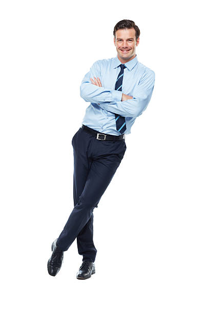 Confident in his business prowess A full length studio shot of a confident looking young businessman leaning against a wall with his arms crossed leaning stock pictures, royalty-free photos & images