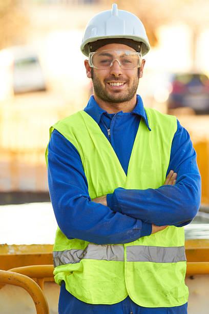 vertrauen in seine fähigkeit konstruktion - handwerker mittags stock-fotos und bilder