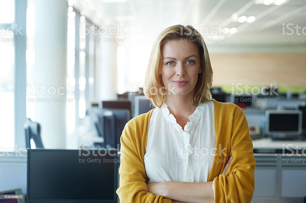 Confident in my career Portrait of a businesswoman standing with her arms folded in the office 30-39 Years Stock Photo