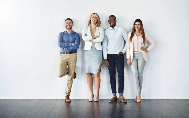 Confident individuals make a confident team Studio shot of a diverse group of confident businesspeople leaning stock pictures, royalty-free photos & images