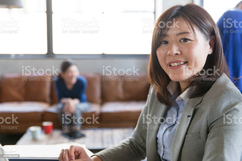Confident Japanese Woman at office stock photo