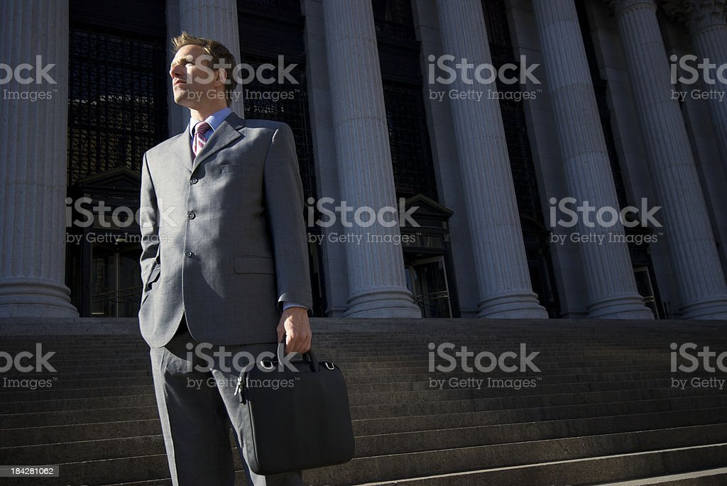 Confident Lawyer Businessman Standing Outdoors on Courthouse Steps stock photo