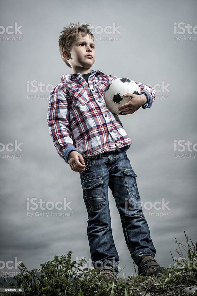 confident little boy holding a ball royalty-free stock photo