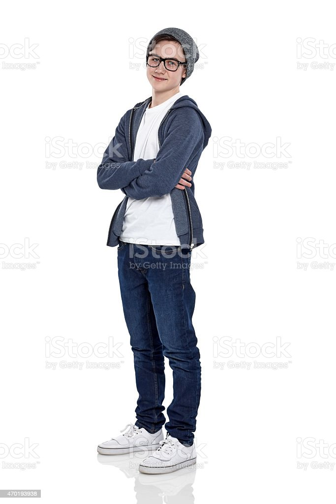 Confident little boy posing in studio stock photo
