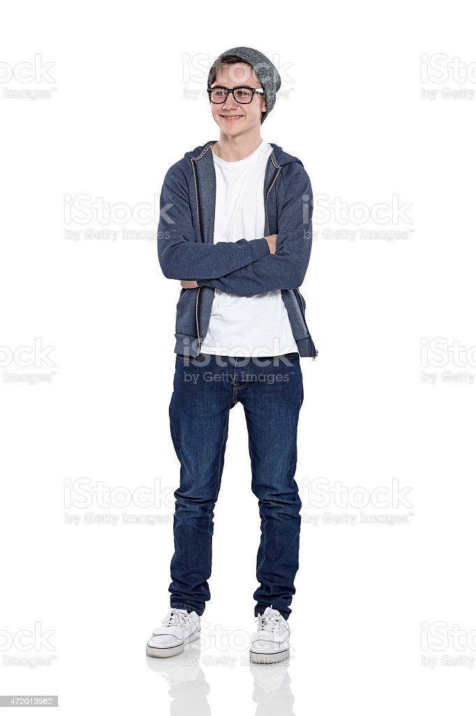 Confident little boy posing in studio stock photo