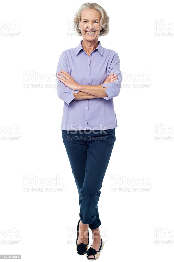 Confident looking aged woman in casuals stock photo