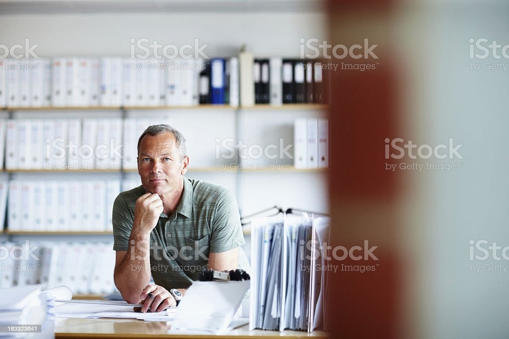 Confident male architect working on a new project royalty-free stock photo