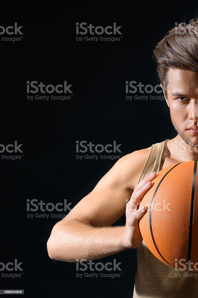 Confident male athlete playing basketball royalty-free stock photo