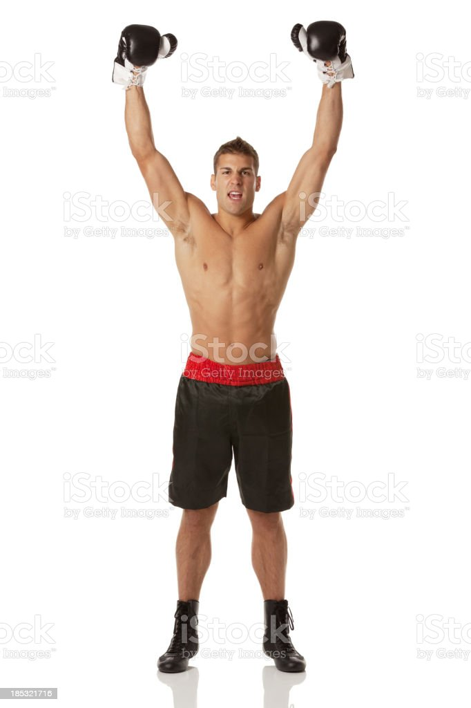 Confident male boxer celebrating his success royalty-free stock photo
