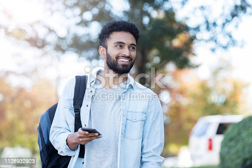 istock Confident male college student on campus 1128932923