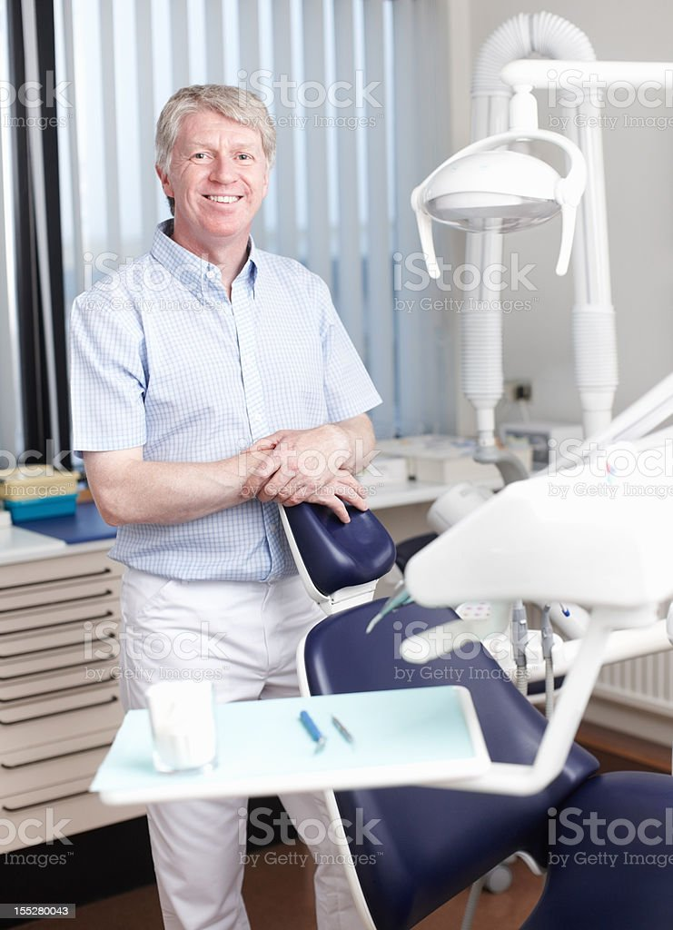 Confident male dentist royalty-free stock photo