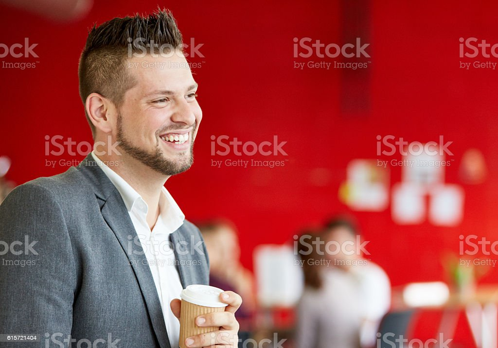 Confident male designer having a coffee at work in red – Foto