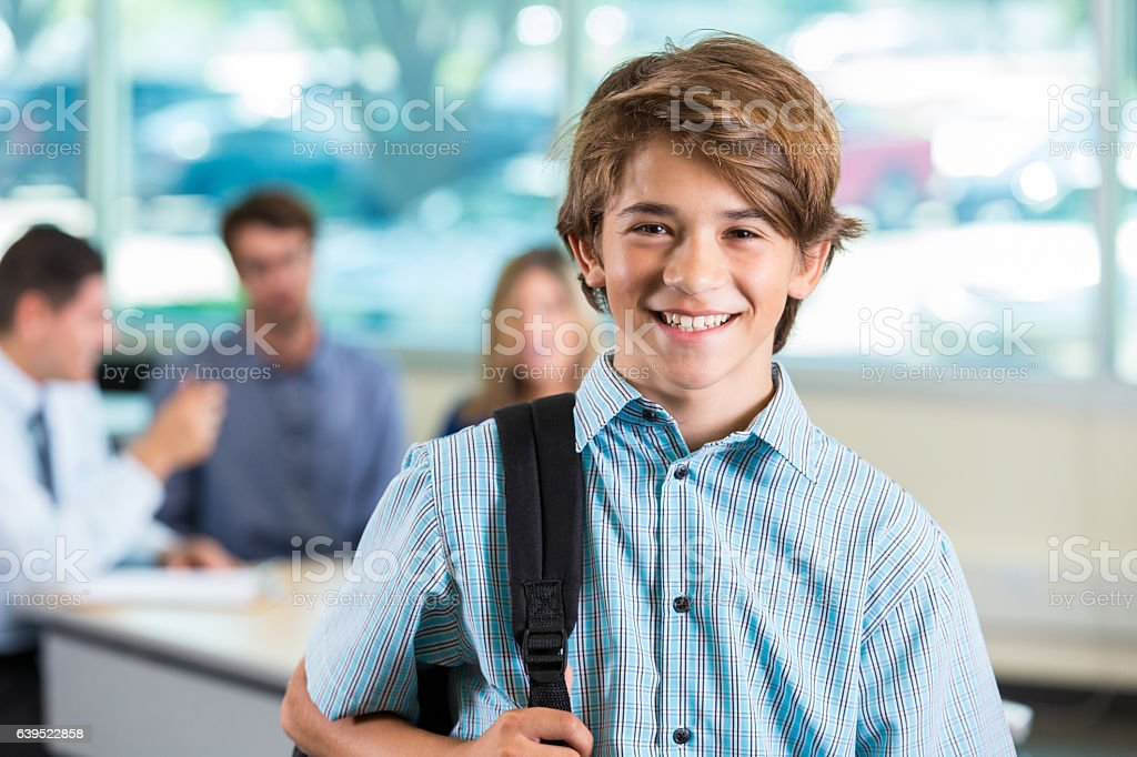 Confident male high school student stock photo