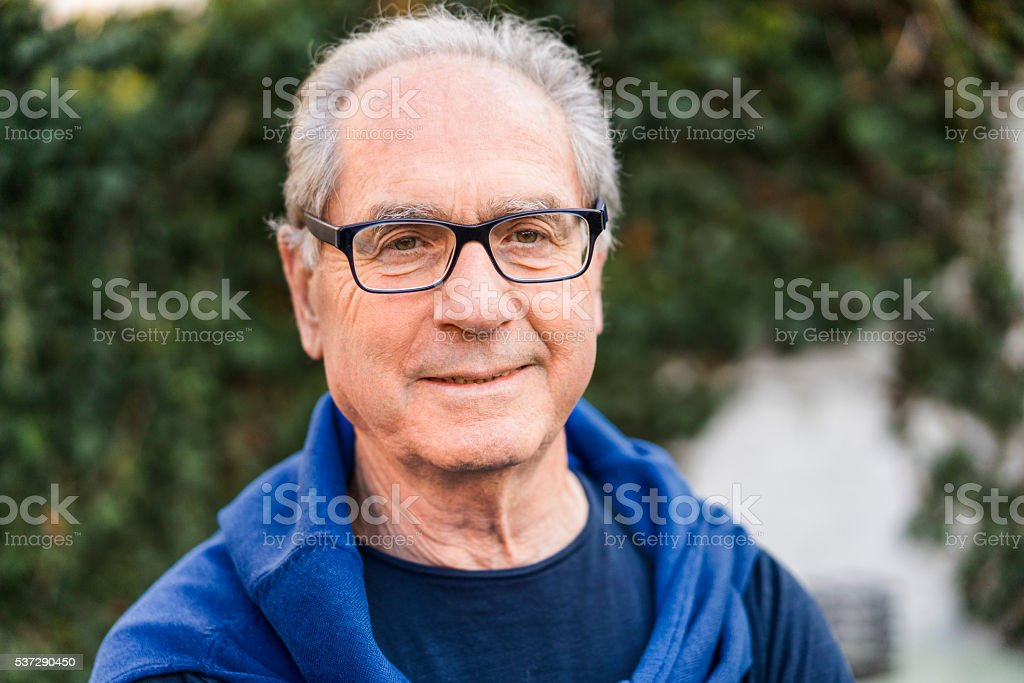 Confident male is wearing eyeglasses stock photo