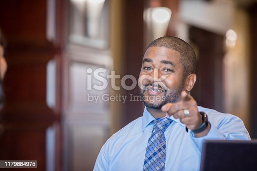 538177146 istock photo Confident male professional points encouragingly 1179884975