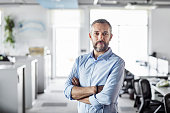 istock Confident male professional with arms crossed 1208389390