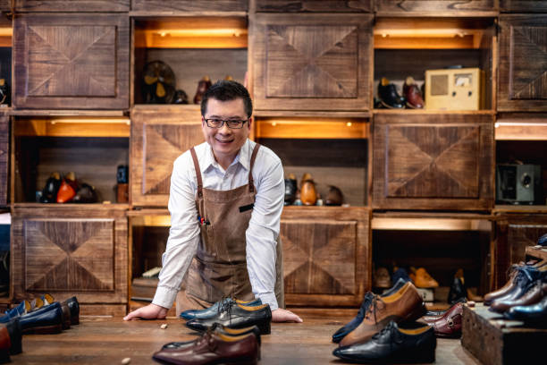 confident male taiwanese shoe store owner - small business owner stock pictures, royalty-free photos & images