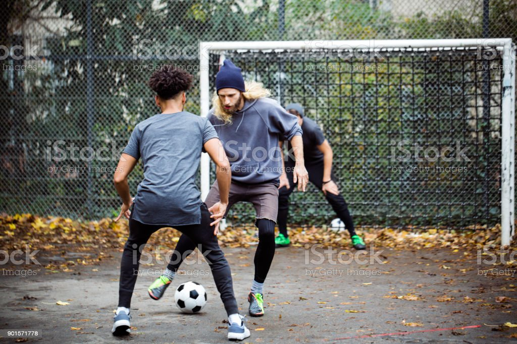 Confident man dribbling ball from opponent royalty-free stock photo