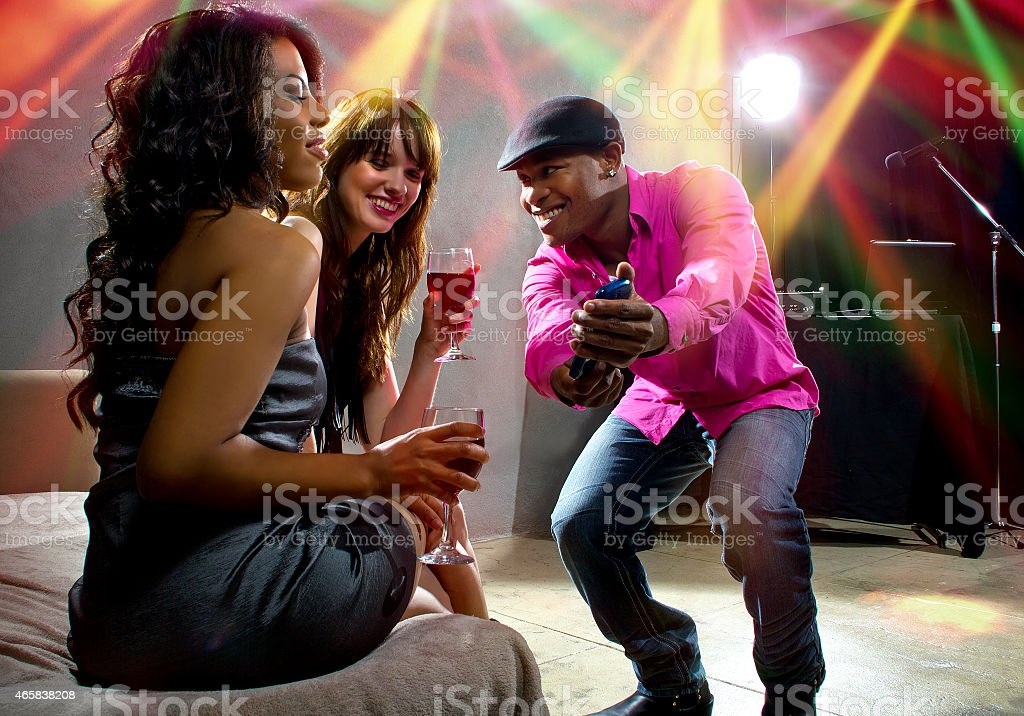 Confident Man Getting a Phone Number at Nightclub stock photo