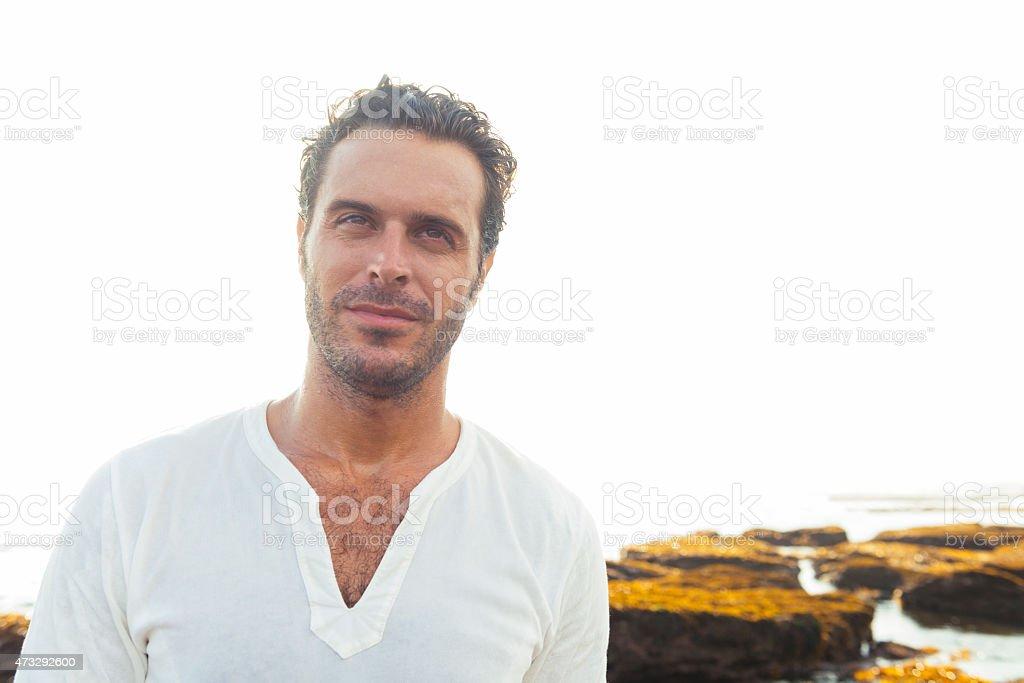 Confident Man in 30s Enjoys Happy Beach Lifestyle Bali Indonesia stock photo
