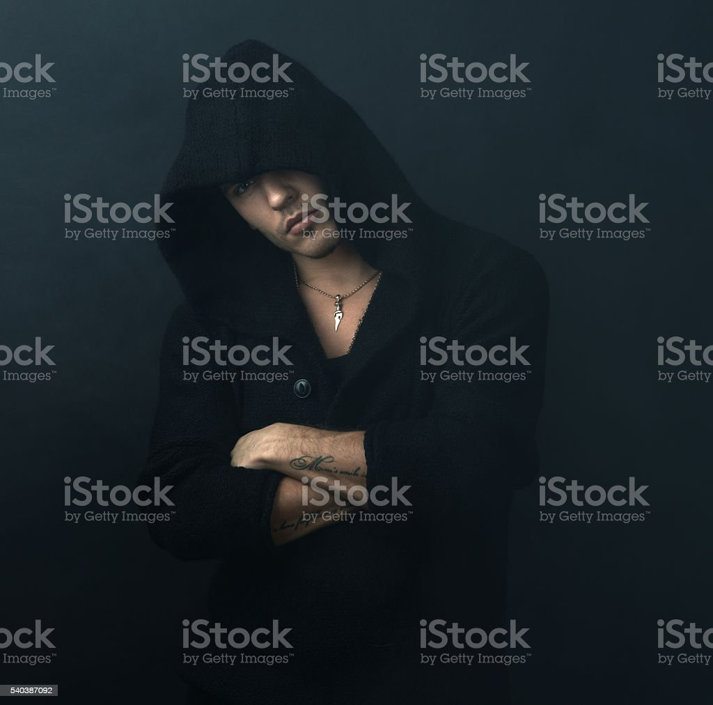 confident man in  black hoodie crossed his arms stock photo