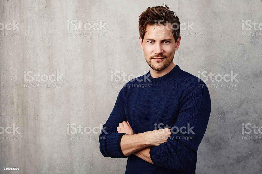 Confident man in blue sweater, portrait stock photo