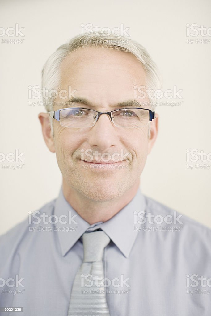 Confident man in eyeglasses smiling stock photo