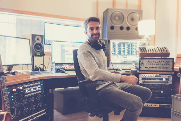 confident man in sound recording studio - producer stock pictures, royalty-free photos & images