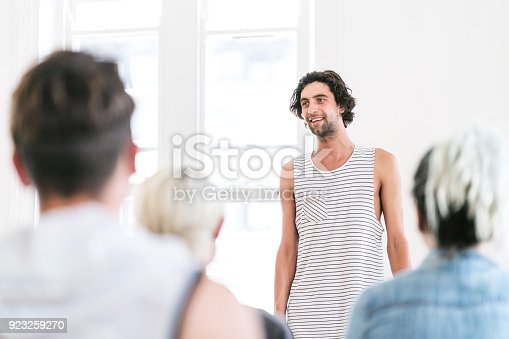 istock Confident man participating in group therapy 923259270