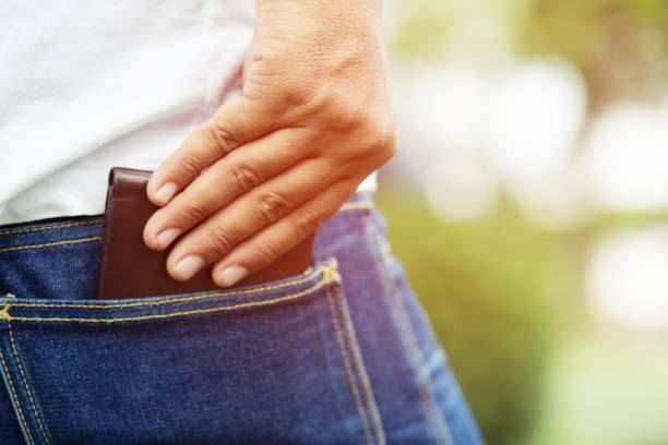 Confident man posing in save keeping your wallet in the back pocket of his back pocket pants jean. savings money. Confident man posing in save keeping your wallet in the back pocket of his back pocket pants jean. savings money. wallet money stock pictures, royalty-free photos & images