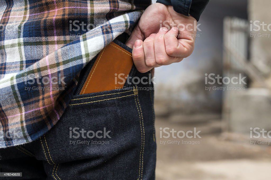 Confident man posing in selvedge  jeans stock photo