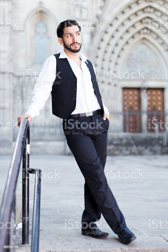 Confident man posing near iron banisters royalty-free stock photo