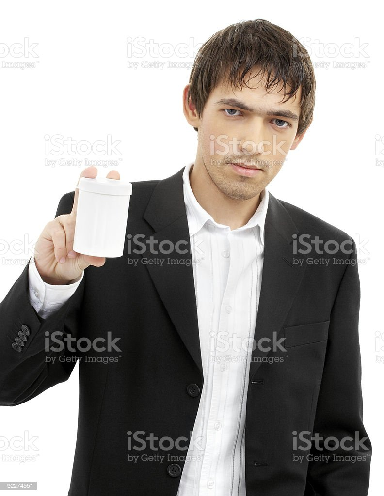 confident man showing blank medication container royalty-free stock photo