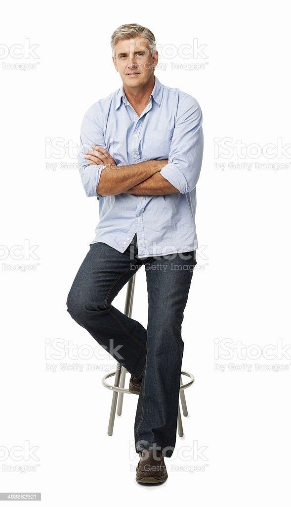 Confident Man Sitting On Stool stock photo