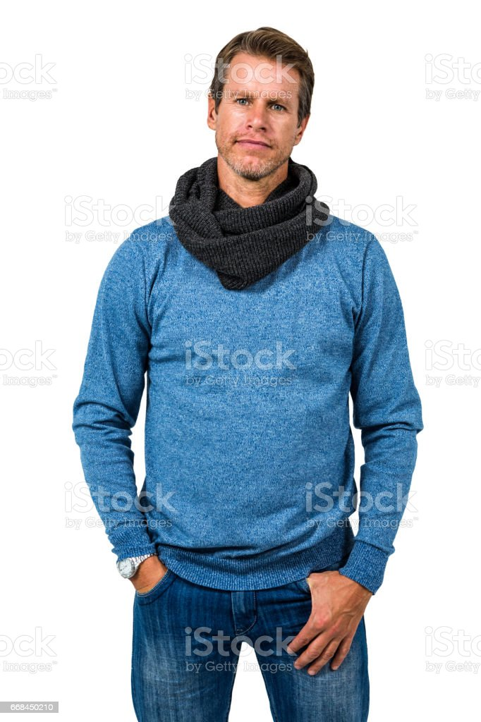 Confident man standing against white background stock photo