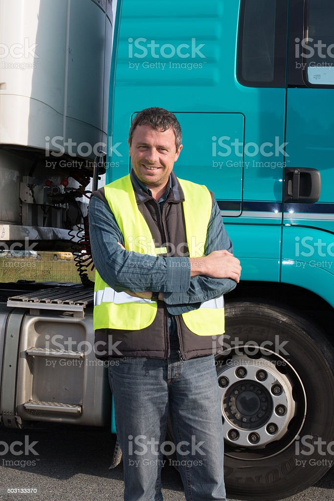 confident Man standing in front of truck stock photo