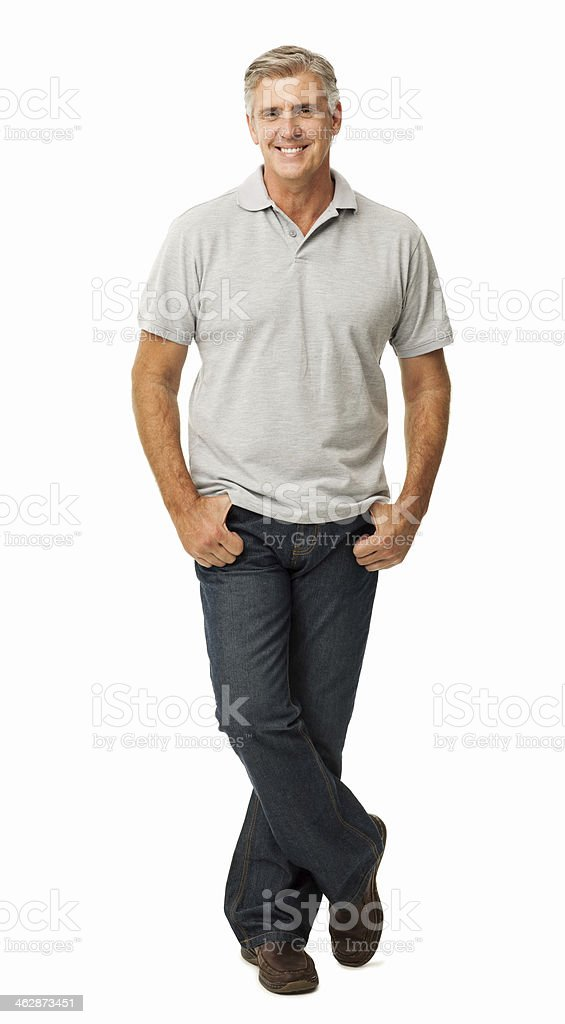 Confident Man Standing With Hands In Pockets stock photo