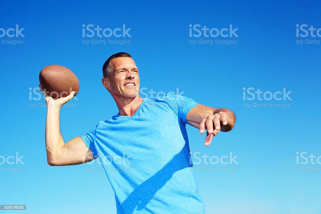 Confident Man Throwing American Football stock photo