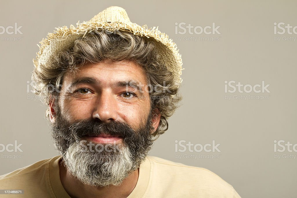 Confident man with beard and straw hat royalty-free stock photo