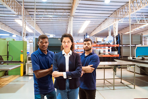 Confident Manager And Workers In Factory Stock Photo - Download Image Now
