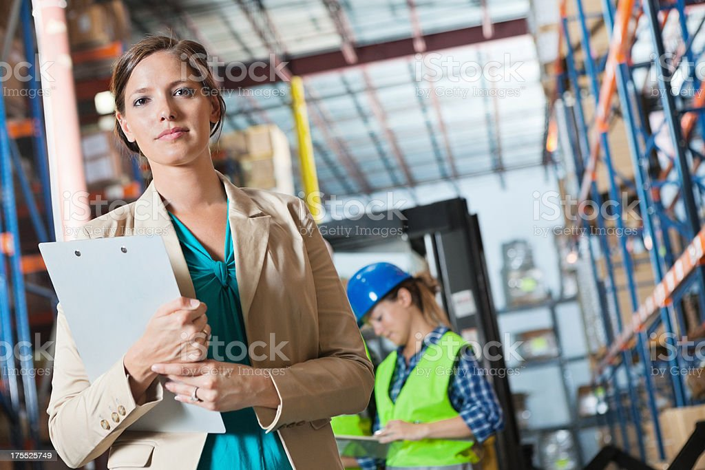 Confident manager in shipping distribution warehouse stock photo