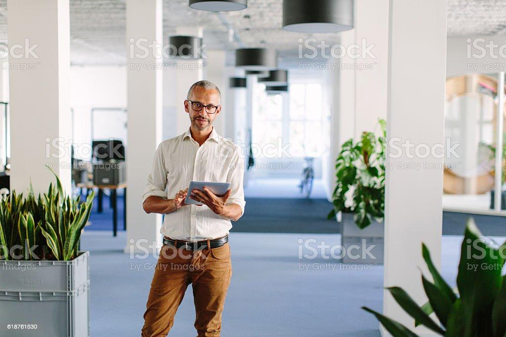 Confident mature businessman at startup stock photo