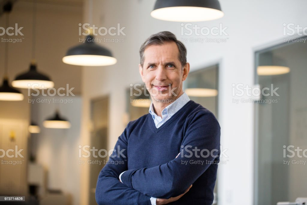 Confident mature businessman in office stock photo