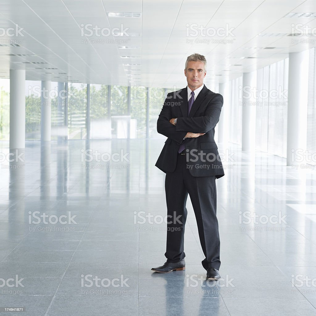 Confident Mature Businessman With Arms Crossed royalty-free stock photo