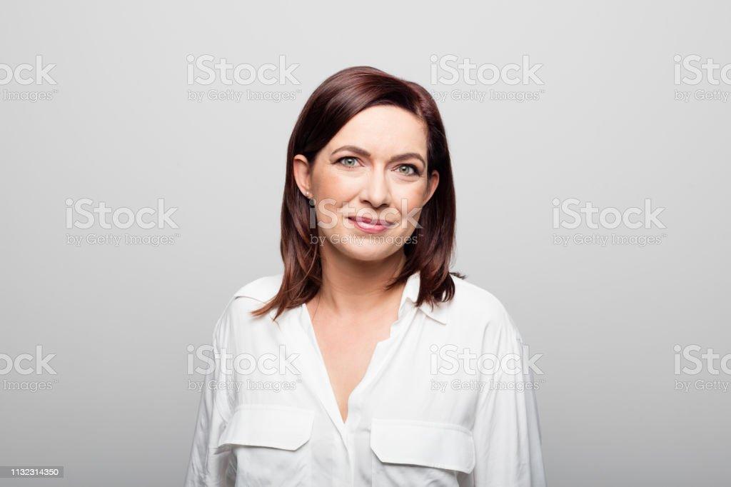 Confident mature businesswoman on white background - Royalty-free 40-44 anos Foto de stock