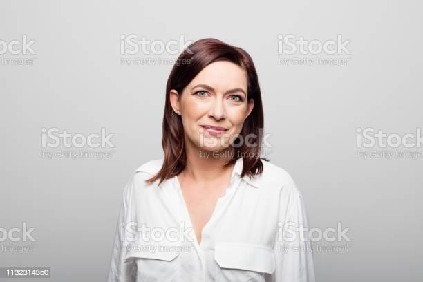 Confident Mature Businesswoman On White Background - Fotografias de stock e mais imagens de 40-44 anos