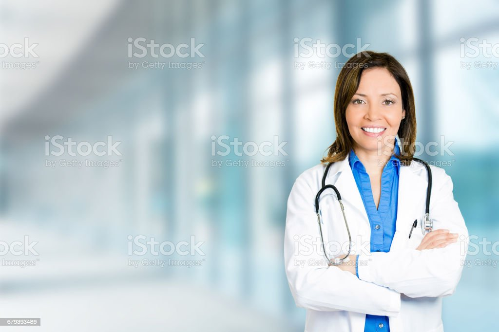 confident mature female doctor medical professional standing royalty-free stock photo
