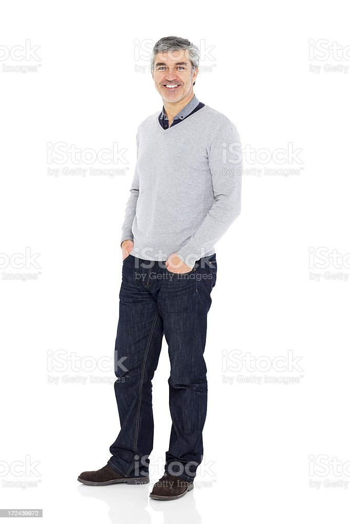 Confident mature man standing on white background stock photo