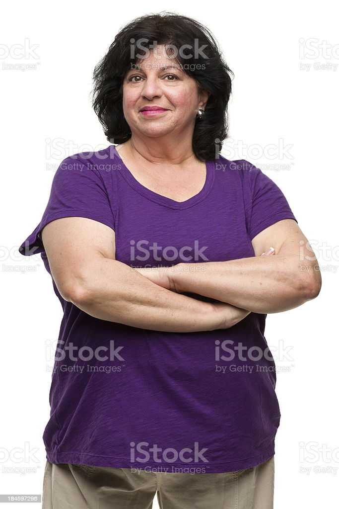 Confident Mature Woman Crosses Arms stock photo