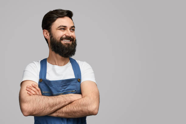 Confident mechanic looking at empty space stock photo